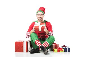 happy smiling man in christmas elf c