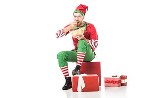 happy man in christmas elf costume s