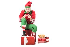 man in christmas elf costume sitting