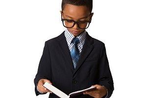 Elegant little boy read the book