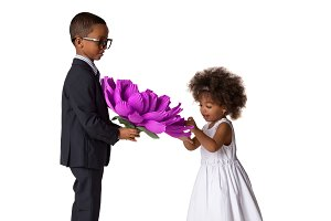 Boy gives to girl big flower