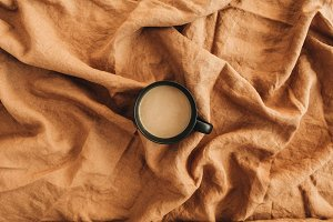 Coffee mug on ginger blanket