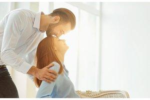 Romantic kiss couple against the