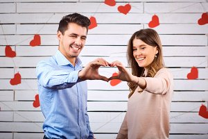 Young happy couple with heart in