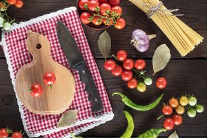 wooden cutting board with a knife