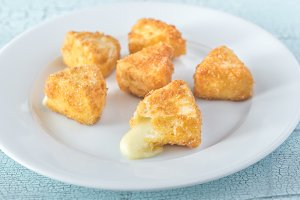 Brie fritters on the white plate
