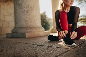 Fitness woman tying her shoe lace