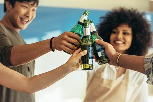 Friends having party toasting bottle
