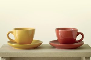 colorful cups on wooden table