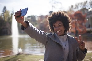 Afro woman having fun in the park