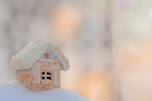 Toy house with colorful snowy bokeh