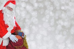 Closeup of Santa Claus with his bag