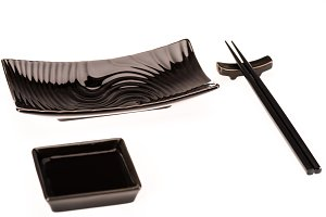 Black dishware for sushi rolls and s