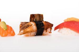 Tasty nigiri sushi isolated on white