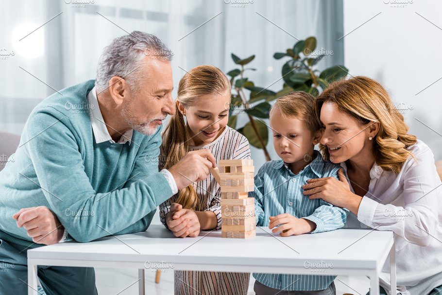 cheerful grandparents and grandchild people images creative market