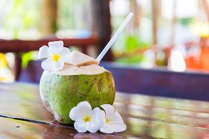 Fresh coconut cuts with tropical pal