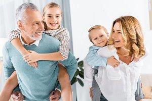 laughing grandparents doing piggybac