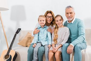 cheerful grandchildren and grandpare