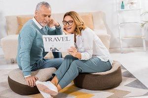 smiling mature couple reading travel