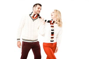 Happy adult couple in knitted scarfs