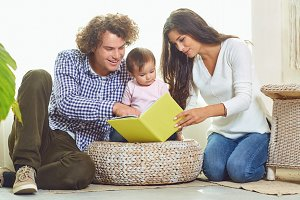 Mother, father and child are reading