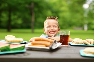 little boy at picnic table