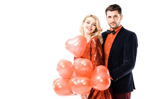 Attractive young couple with red bal