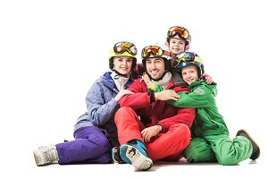 Happy family sitting in snowsuits an