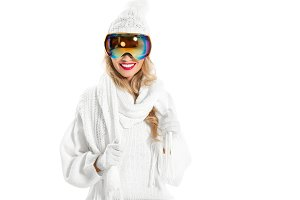 Happy woman in warm white knitted cl
