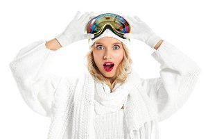 Surprised young woman holding ski go