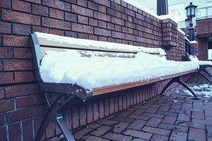 snow on bench chair