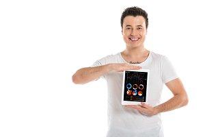 handsome man holding digital tablet