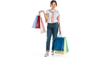 happy young woman holding shopping b