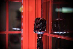A old style retro microphone on red