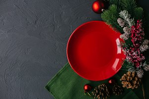 Christmas table with red plate and s