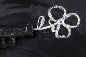 a gun shoots a flower