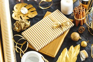 Gifts wrapped in golden paper on tab