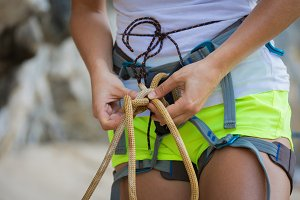 Young woman rock climbing on karst l