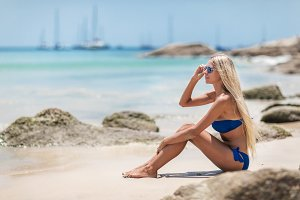 Young pretty blond woman in blue bik