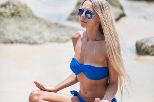 Young pretty blond woman in blue bik