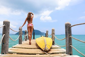 Tropic pier with woman from the back