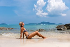 Young woman on white beach near the