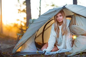 Young blonde woman relax in camping