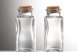 Empty Apothecary bottles on a light