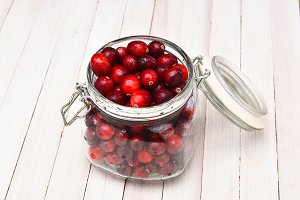 Canning jar filled with cranberries