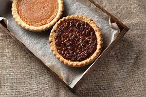 Top view of a pecan and pumpkin pie