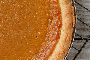 Fresh baked pumpkin pie on a cooling