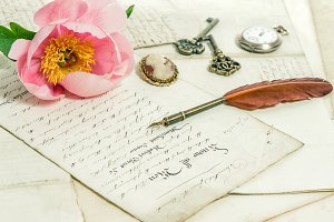 Old letters, pink peony flower