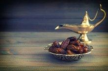 Dates and golden arabian lamp