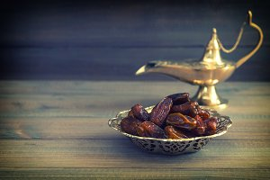 Dates and golden arabian lamp